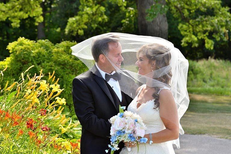 Bride and groom in garden at Bond Head wedding