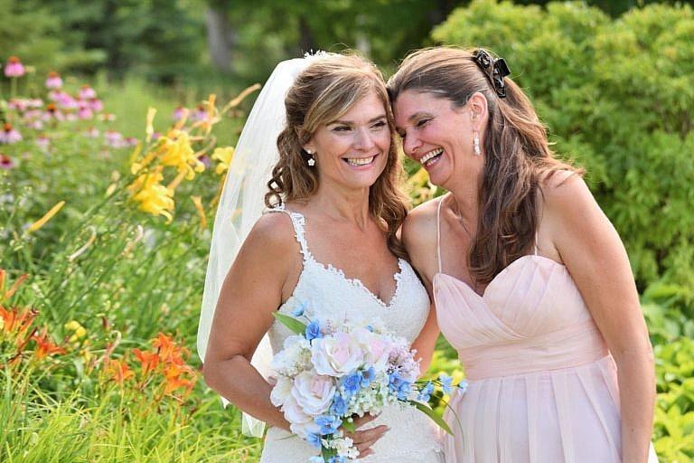 Bride with bridesmaid in garden at Bond Head wedding