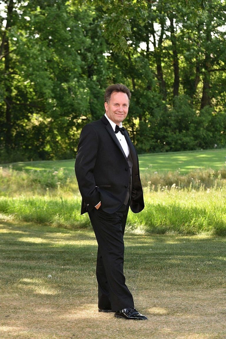 Handsome groom on golf course at Bond Head wedding