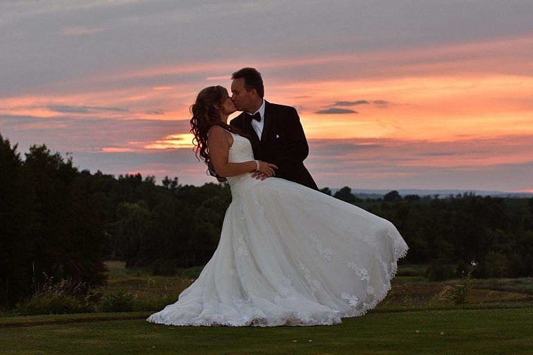 Bride and Groom embrace at sunset at the Club at Bond Head