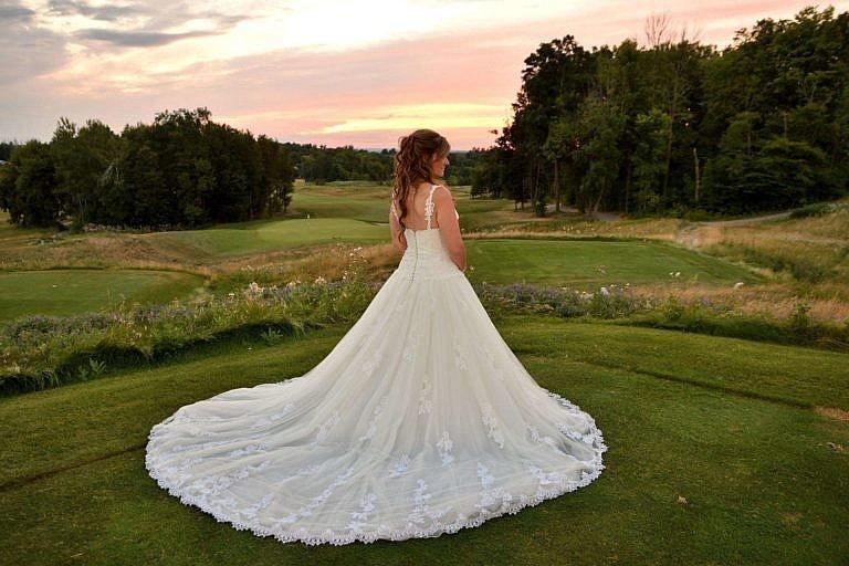 Beautiful bride on golf course at Club at Bond Head wedding
