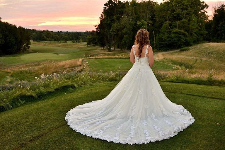 Bride's train on golf course at Club at Bond Head wedding