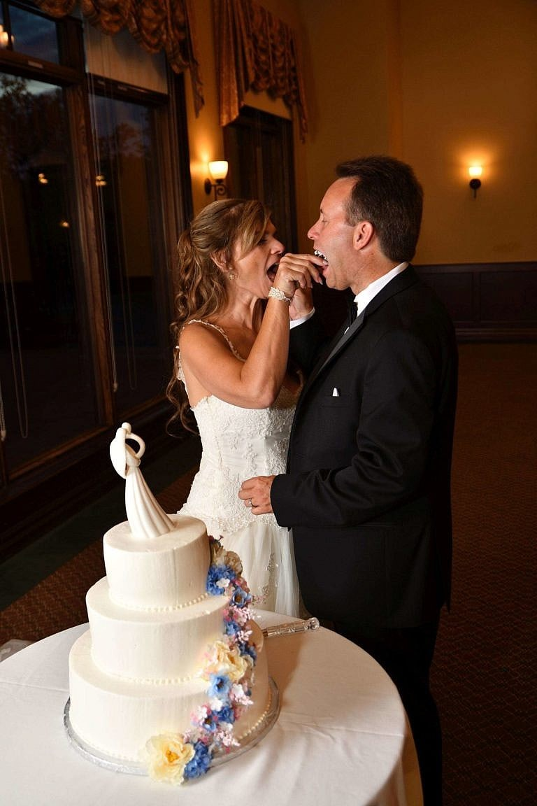 wedding couple feeds cake to each other at bond head wedding