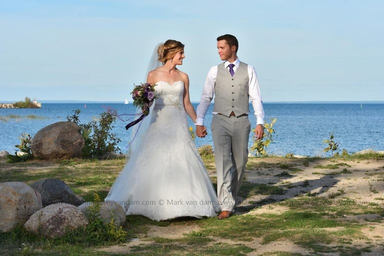 Bride and Groom walk hand in hand at Bear Estate in Collingwood, ON