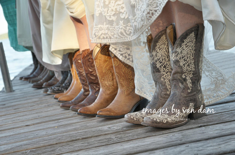 close up of bridesmaids wearing cowboys, standing on dock