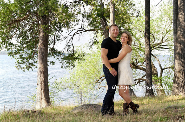 Country themed engagement session on grassy hill by lake