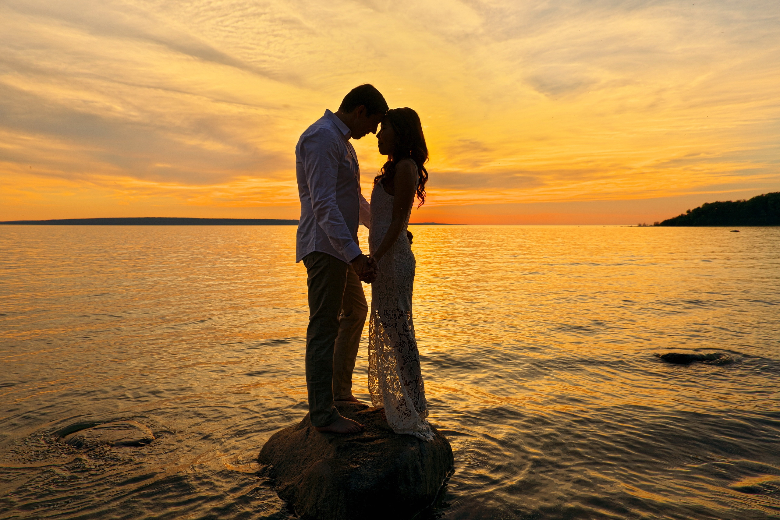 couple stares into each other's eyes at sunset on georgian bay