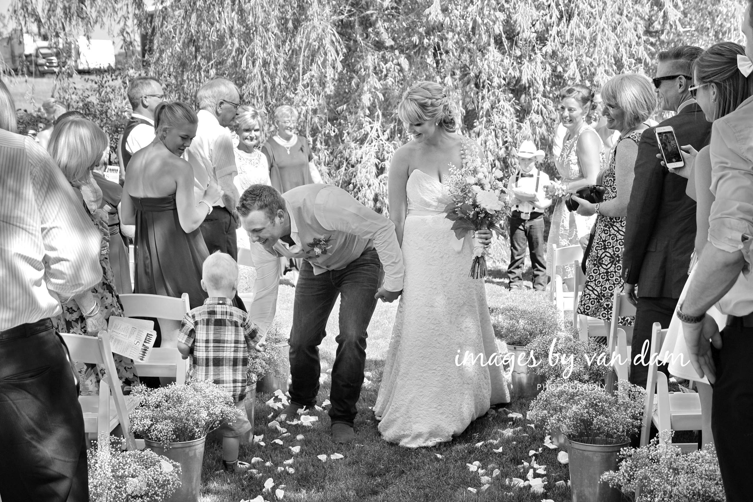 Groom stops to Shake Hand of Young Boy During Recessional