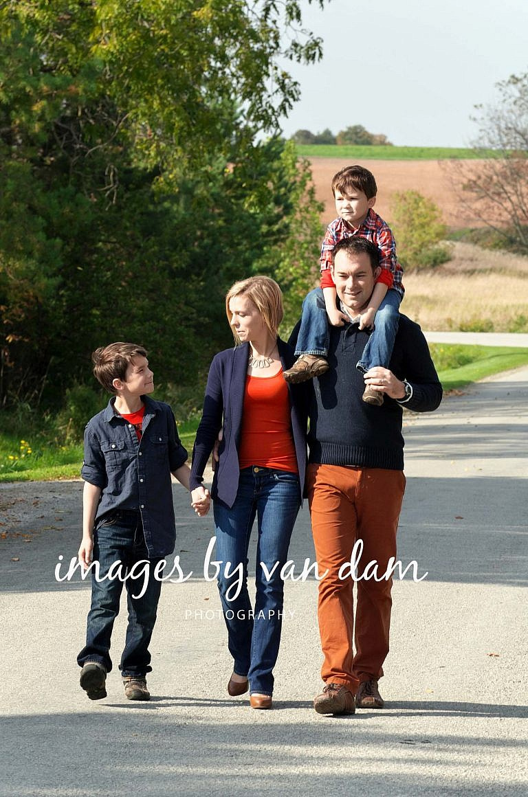 Young Family Walks Down Country Road stayner photographer barrie photographer family portraits wasaga photographer collingwood photographer