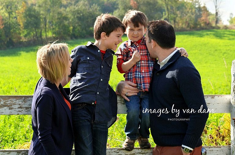 A Young Family Shares a Moment of True Affection at the Farm stayner photographer barrie photographer family portraits wasaga photographer collingwood photographer