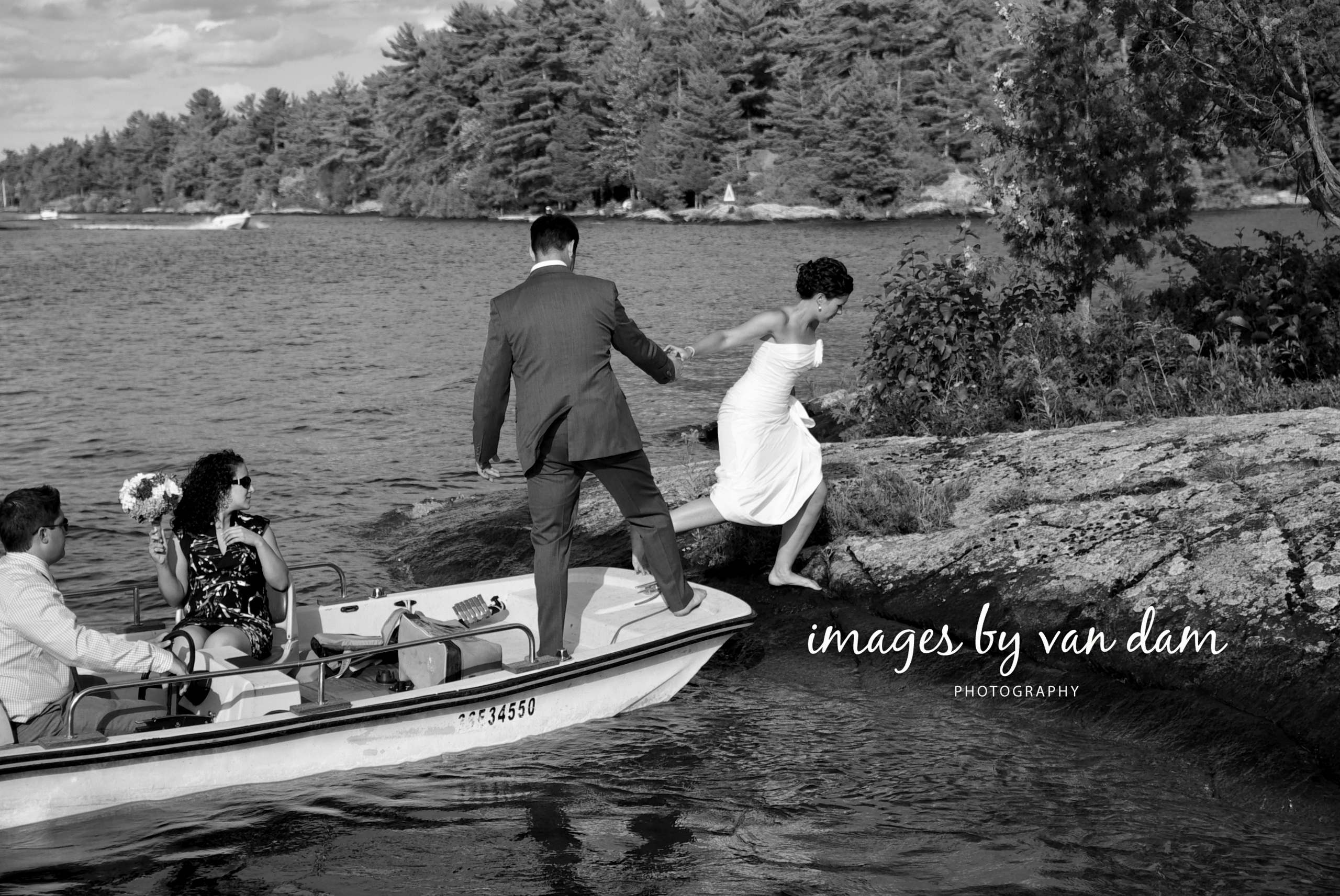 A bride hops off a motorboat onto an island for a wedding photography session