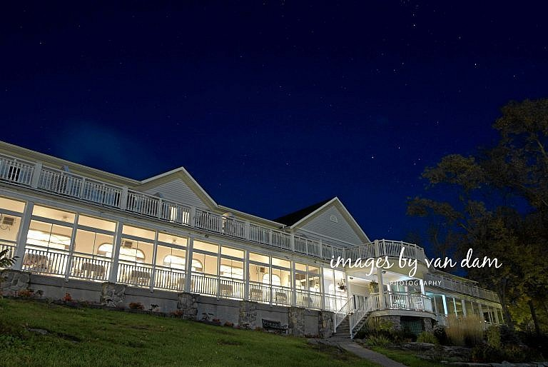 Viamede Resort wedding: hotel lit up by light with stars shining above