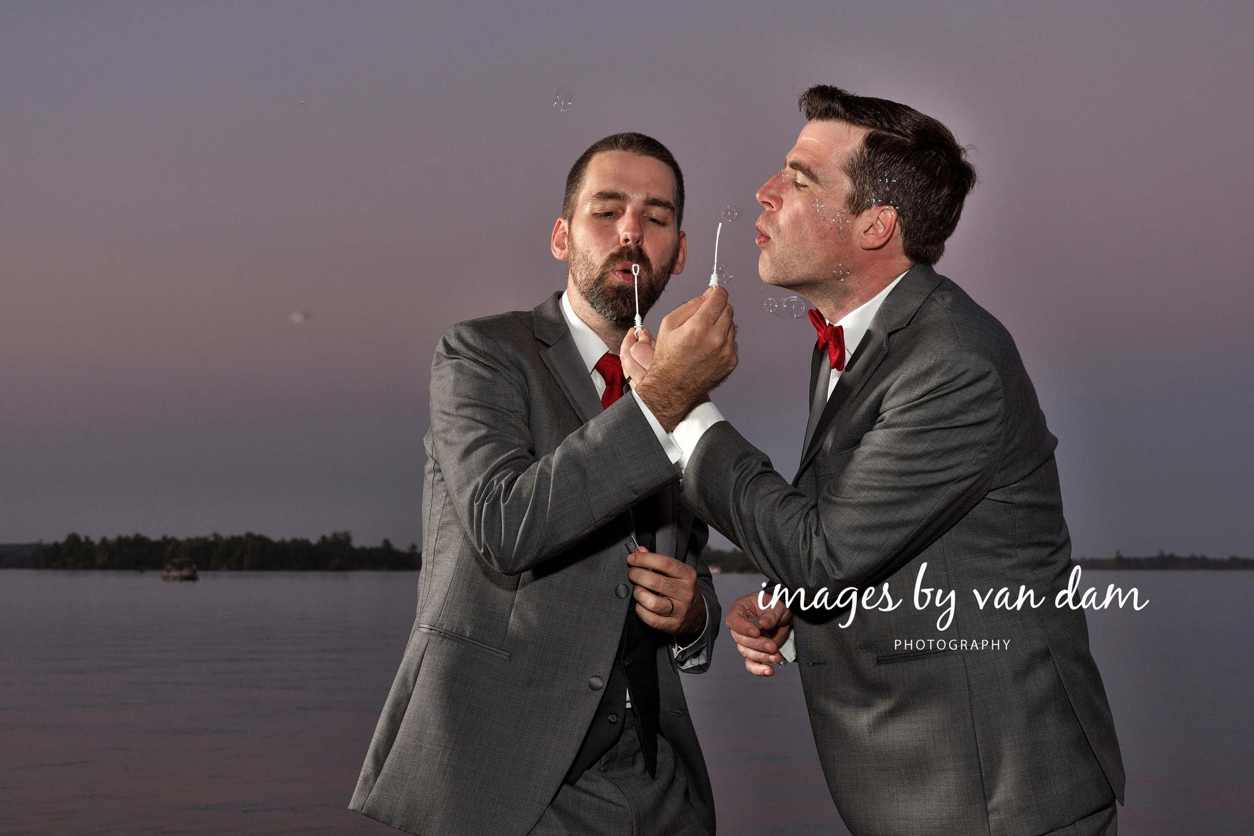 Two Grooms Blow Bubbles
