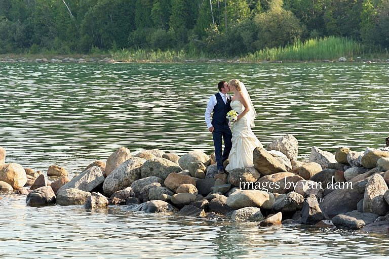 bride and groom kiss on rocks near Thornbury