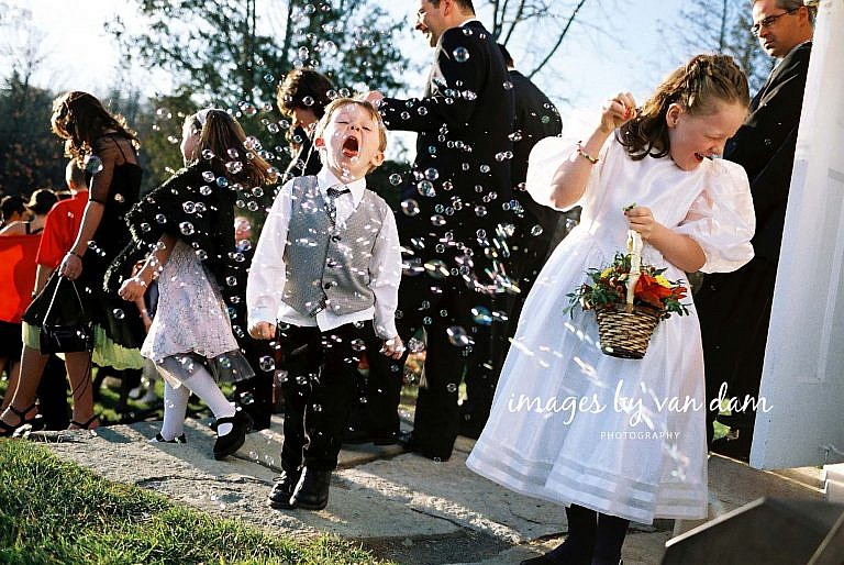 Boy catches bubbles with his mouth at Peterborough wedding