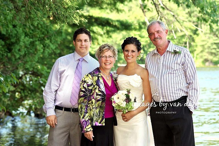 Family wedding photography on dock at Stoney Lake wedding