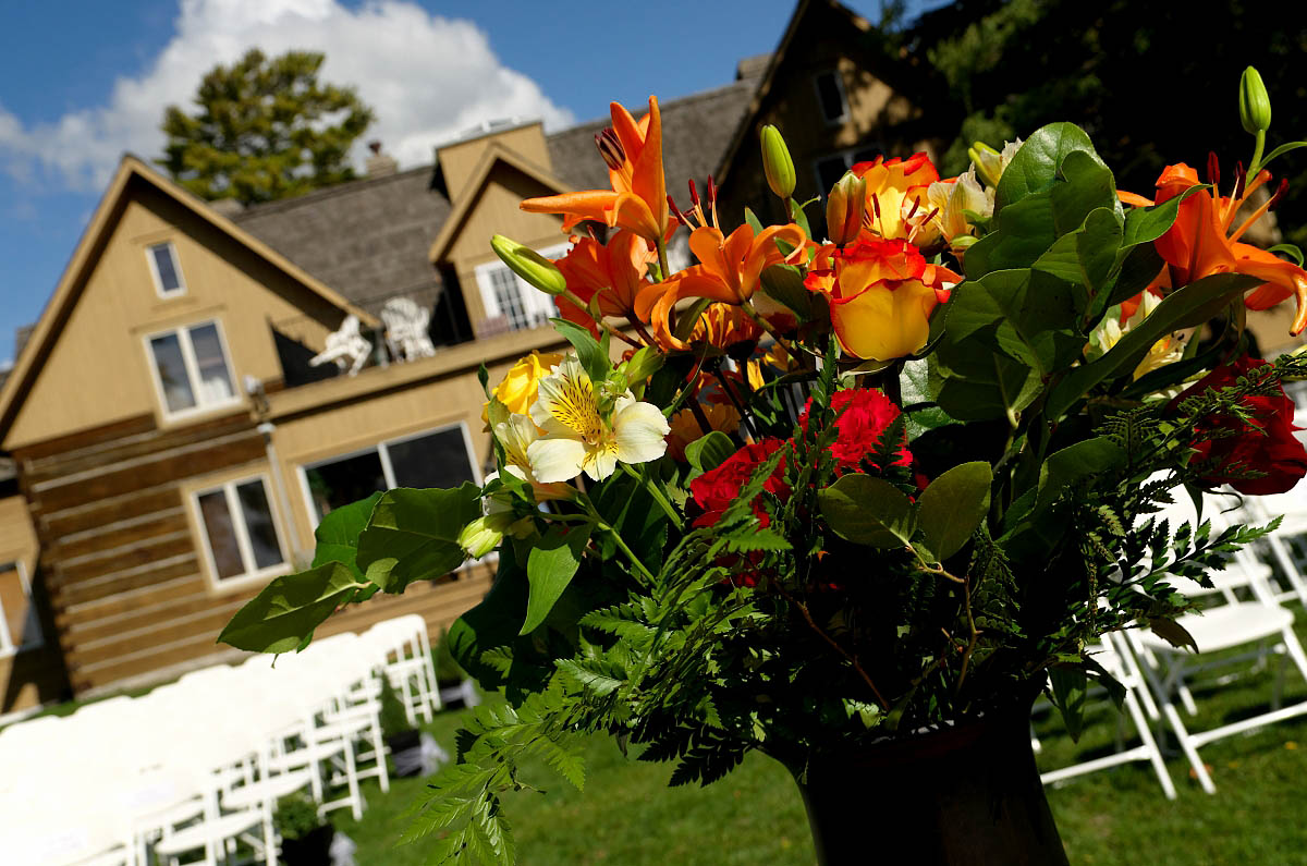 Wedding bouquet and ceremony chairs lined up in front of the historic Dunsford House at Eganridge Resort in Fenelon Falls near Bobcaygeon