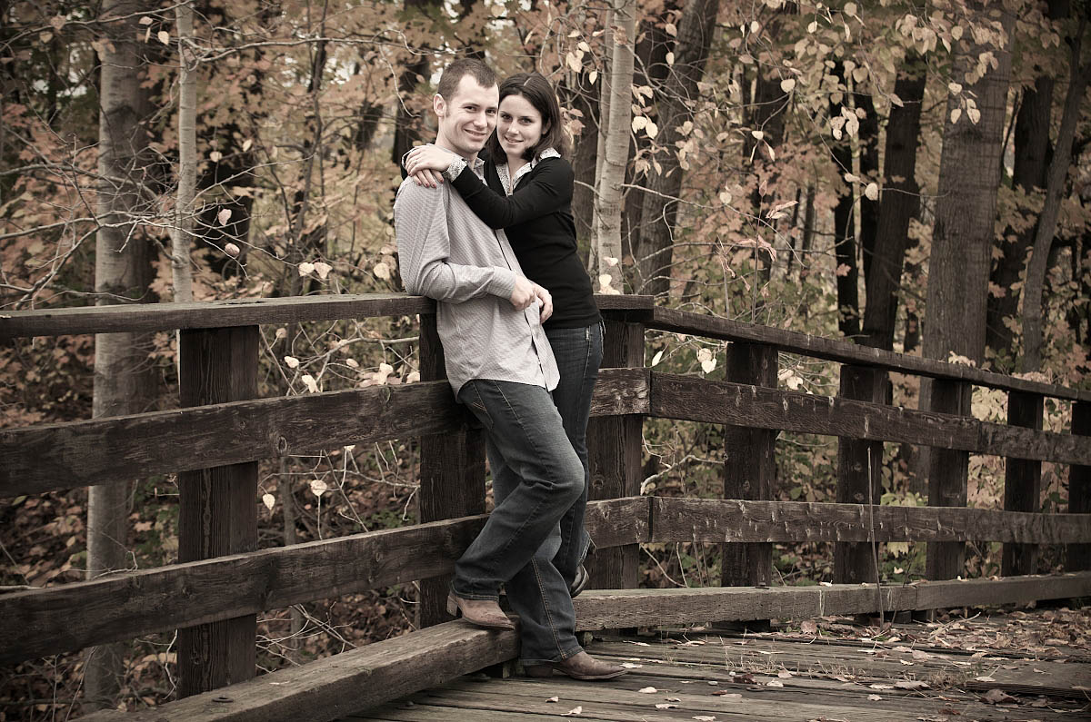 Young couple on wooden bridge over Omemee Rail Trail