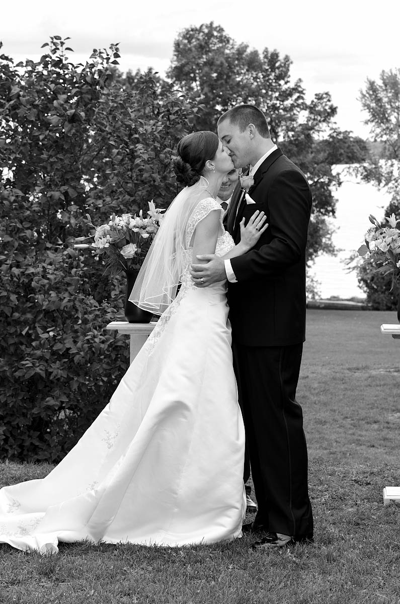 Summer wedding ceremony at The Dunsford House at Eganridge Resort overlooking Sturgeon Lake