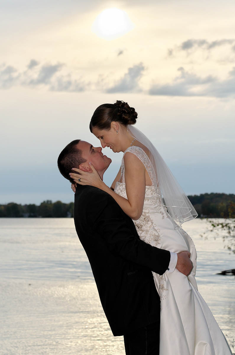 Groom lifts his bride in his arms at Eganridge wedding