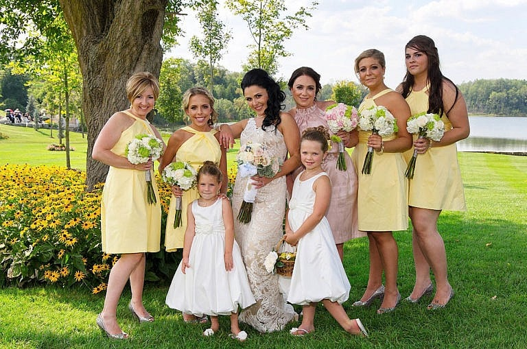 bridesmaids in garden at royal ambassador