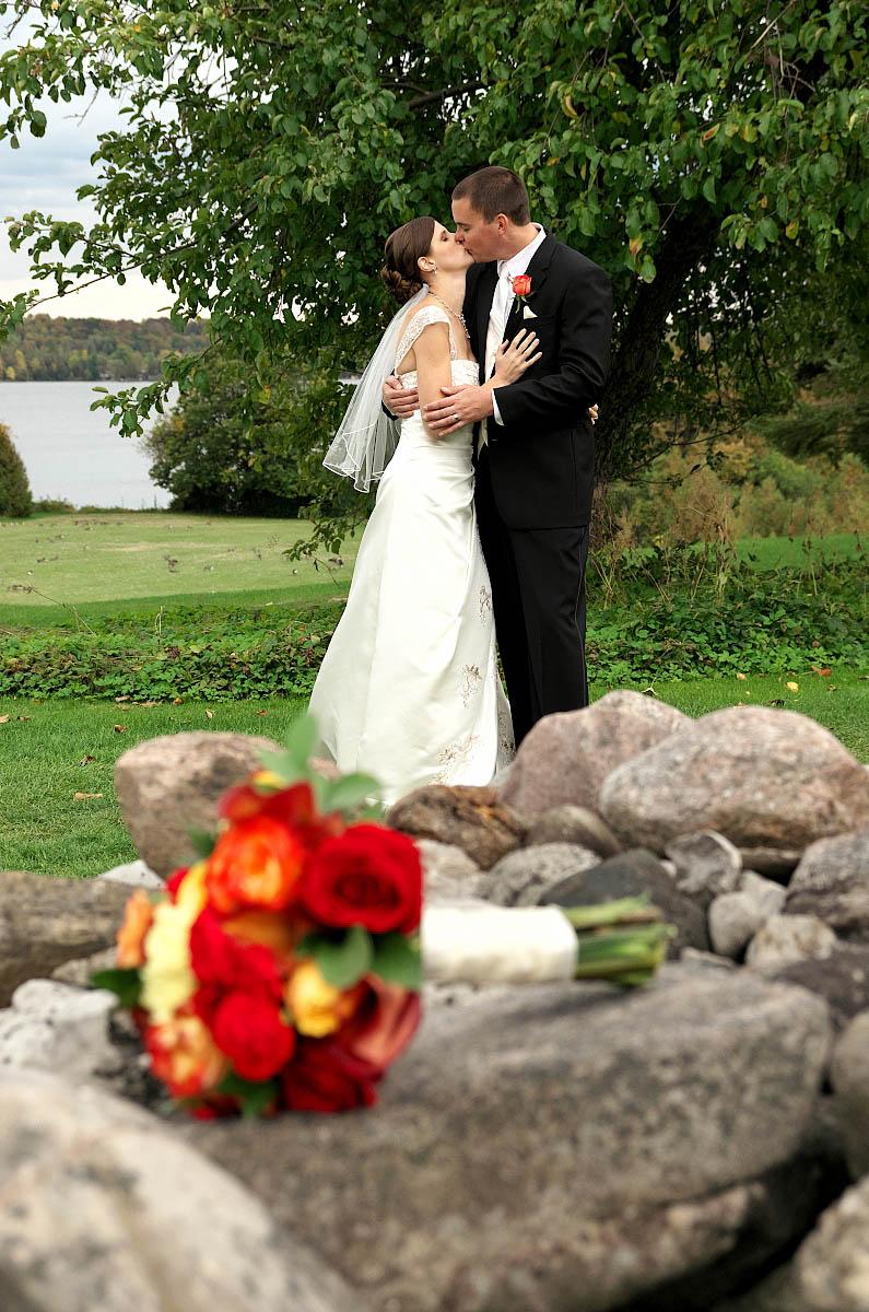 Wedding couple wiith bouquet and old stone wall at Eganridge wedding