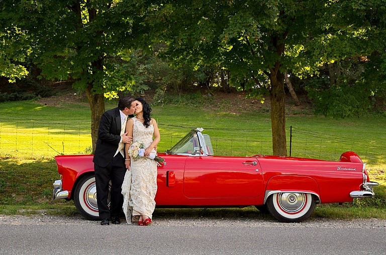 wedding couple with vintage car at caledon wedding at royal ambassador