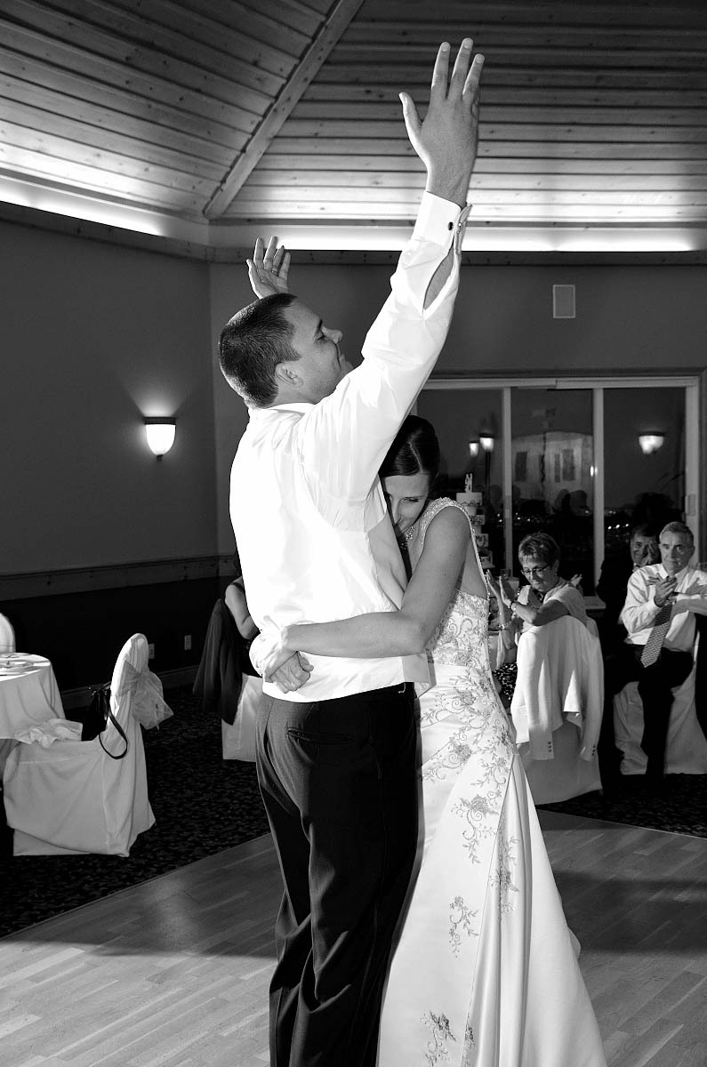 First dance at Eganridge Resort wedding with a triumphant groom