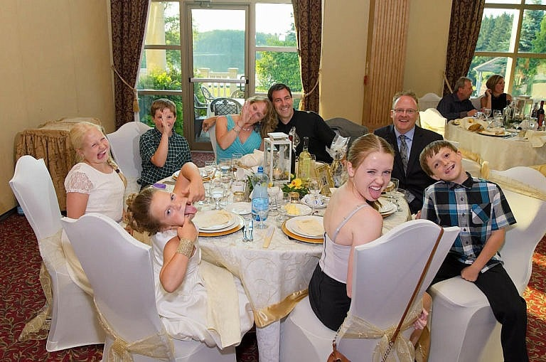 Funny faces during table shot at Royal Ambassador wedding