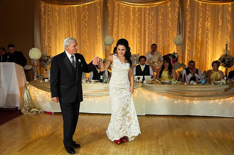 Bride dances with her father at Royal Ambassador wedding reception