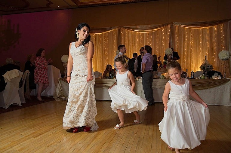 bride dances with flower girls at wedding reception at Caledon wedding