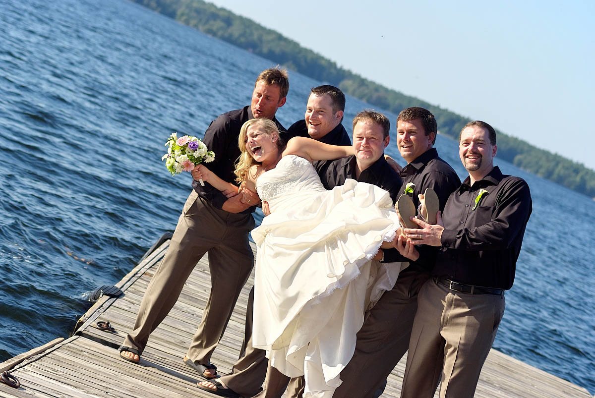 Groomsmen about to Throw bride in Water
