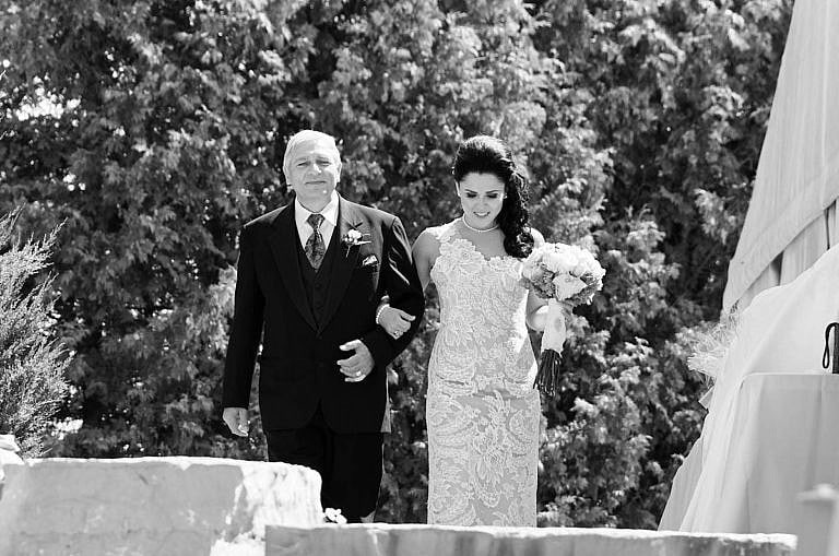 Bride walks down the aisle with her father at Royal Ambassador Caledon wedding