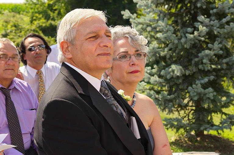 proud parents watching wedding ceremony