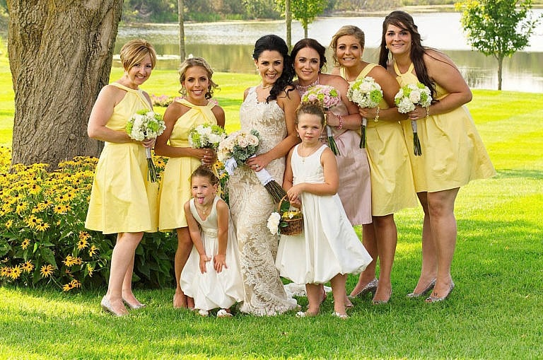 Bridesmaids in garden at Royal Ambassador wedding