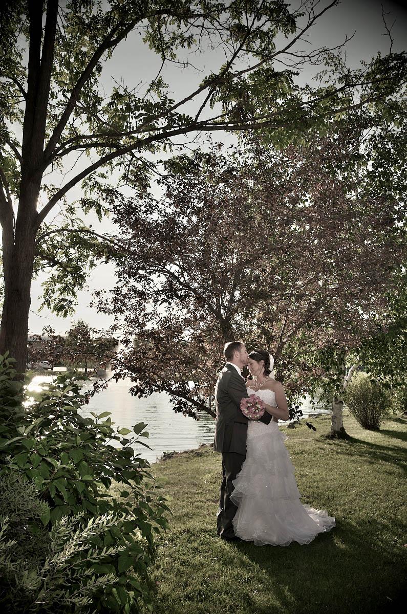 bride and groom by lake nottawasaga