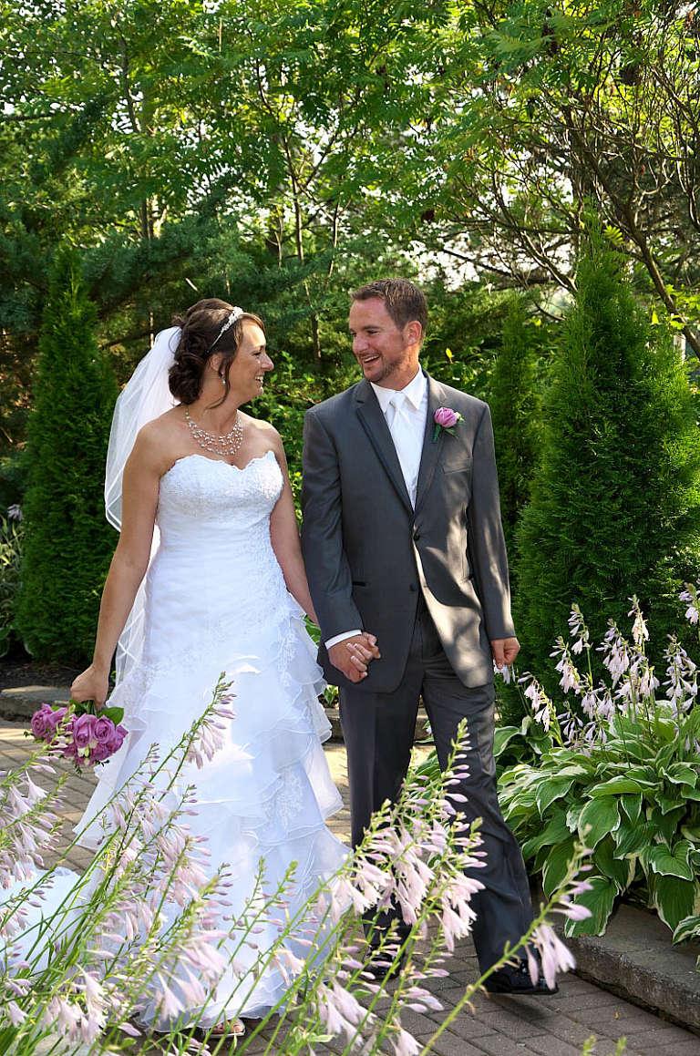 bride and groom hand in hand nottawasaga