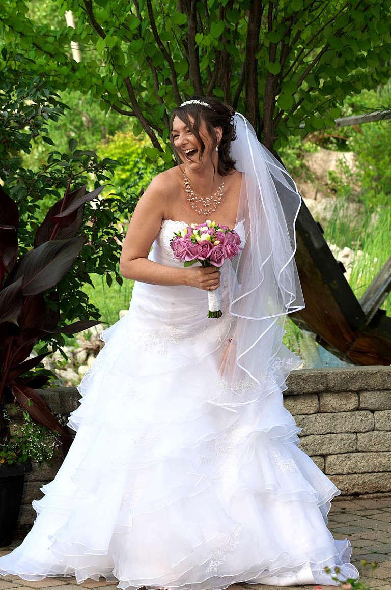 bride laughing nottawasaga wedding garden