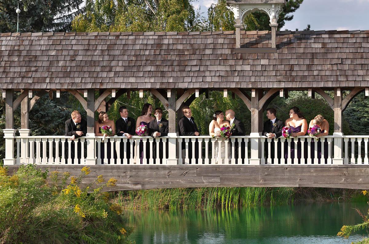 wedding party on belcroft tree farm covered bridge