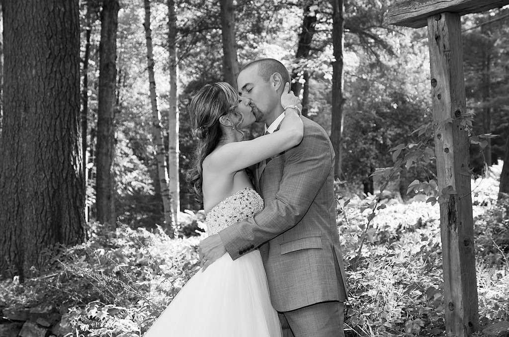 wedding couple kissing in forest haliburton wedding photography