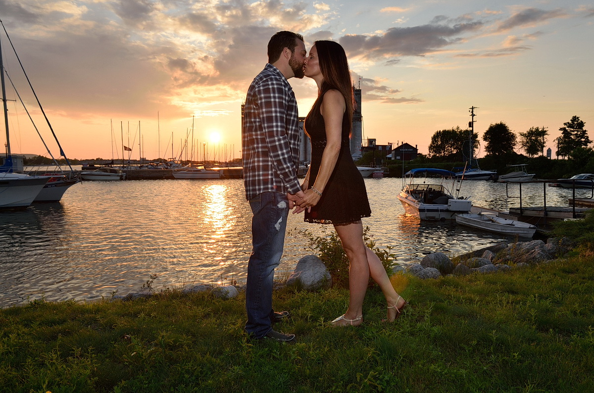 Couple kisses at sunset in front of Collingwood Yacht Club