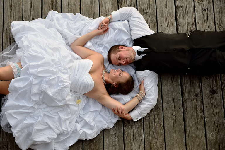 wedding couple on dock at discovery harbour