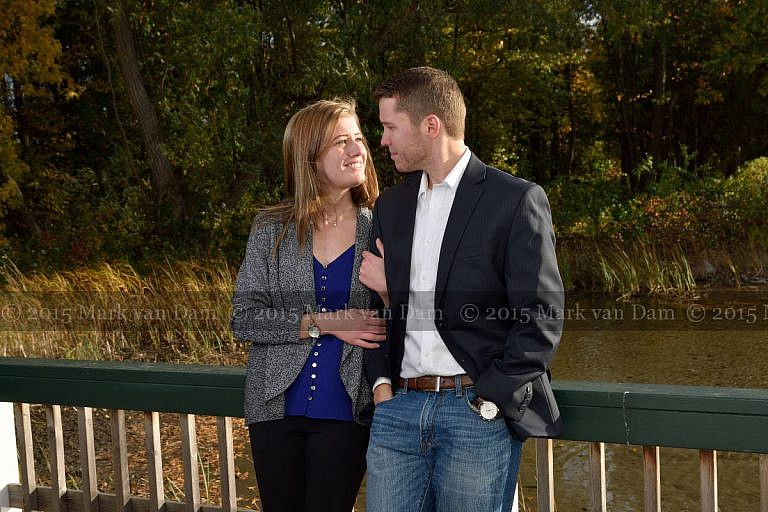 Stylish couple leans against boathouse railing at Leacock Museum engagement photography session