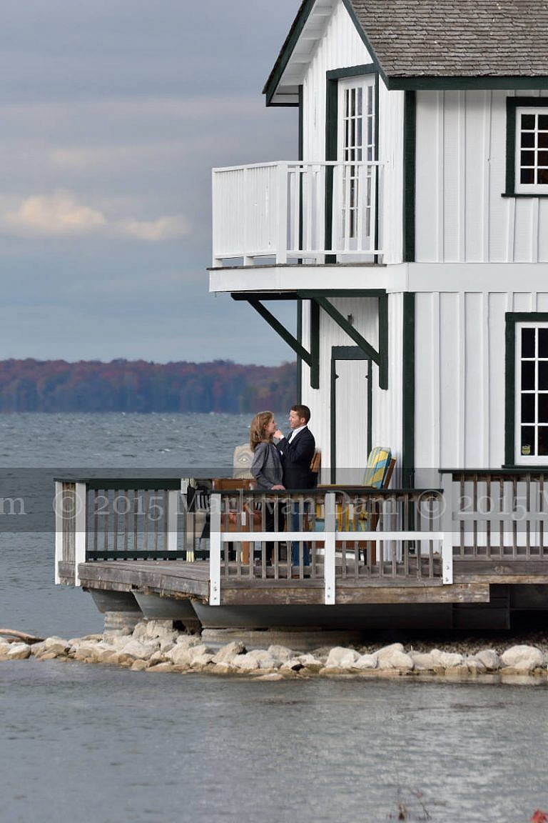 Stylish couple on boathouse deck at Leacock Museum engagement photography session