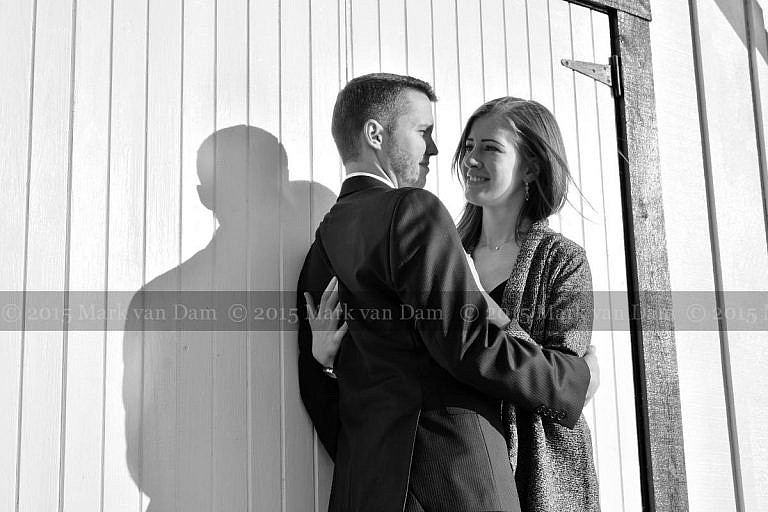 Leaning against the Leacock Museum boathouse during an Orillia engagment session