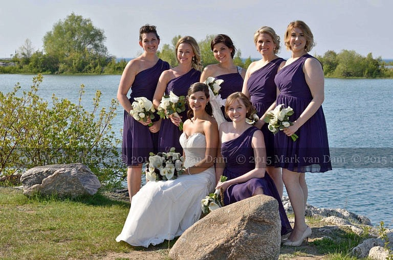 Collinwood photographer, bridal party on rocks by water at Cranberry Resort wedding