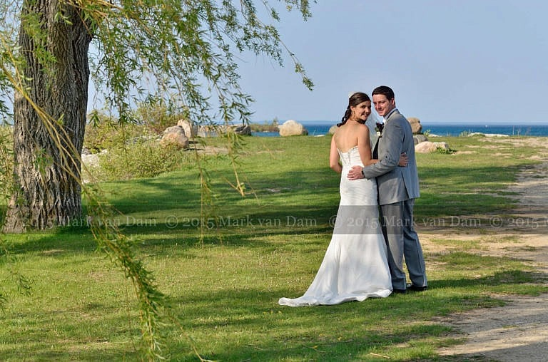 Bear Estate Wedding in Collingwood, couple strolling beneath the willow trees by Georgian Bay in Collingwood