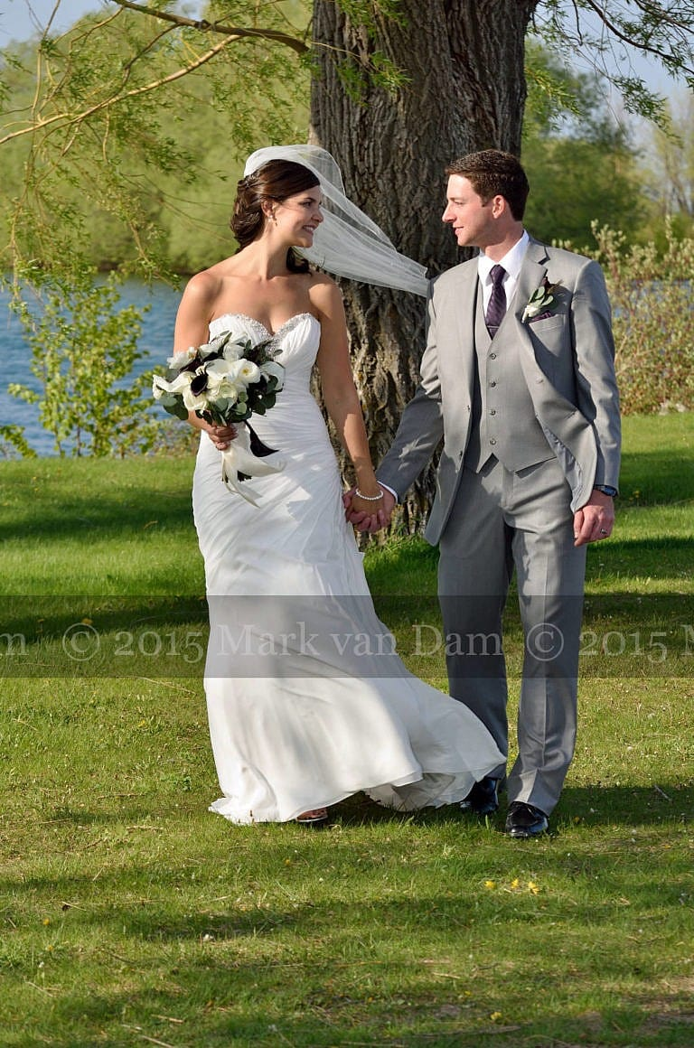 Collingwood photographer, wedding couple walks hand in hand beneath giant willow trees at Cranberry Resort Bear Estate Living Waters wedding