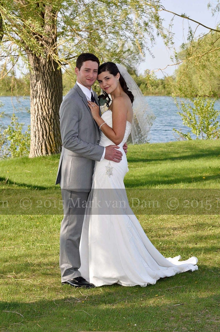 Collingwood photographer, wedding couple shares a moment beneath giant willow trees at Cranberry Resort Bear Estate Living Waters wedding