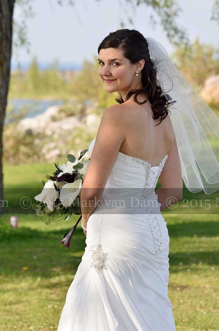Beautiful bride by Georgian Bay at Living Waters Resort at The Bear Estate at Cranberry Resort